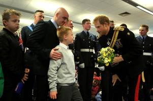 touching exchange as son of scots raf officer with terminal cancer greets prince harry with special gift