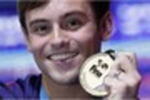 Tom Daley wins world diving title in Budapest