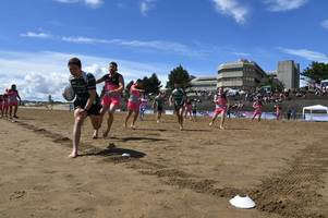 hundreds of players took part in a beach rugby tournament in swansea
