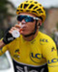 Tour de France: Chris Froome celebrates with CHAMPAGNE on bike as he takes fourth title
