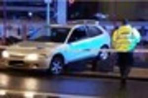 car lodged on top of bins after city centre crash which left man...
