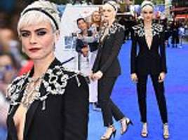 cara delevingne flashes flesh from beneath burberry suit