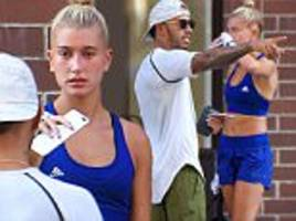 Hailey Baldwin chats with Lewis Hamilton outside NYC gym