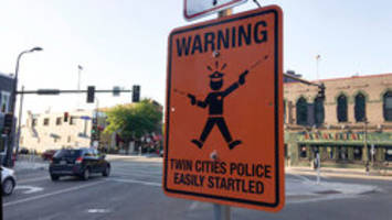 warning: fake signs about 'easily startled' cops pop up in minneapolis