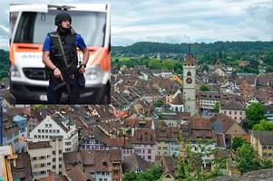 Police hunt 'bald and unkempt' man after chainsaw rampage through picturesque Swiss town leaves five shoppers injured