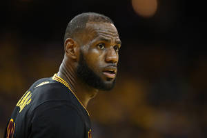 lebron james plans to stay with the cavs until end of contract; kyrie irving reportedly requested a trade