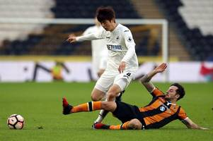 ki sung-yueng to return to swansea city this week for assessment on the knee injury that has derailed his pre-season