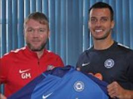 Ex-Newcastle captain Steven Taylor signs for Peterborough