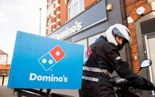 domino's takes a bigger slice of profits and sales