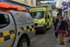 falmouth coastguard cliff rescue team helps injured elderly woman...