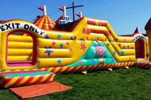 there's an amazing inflatable theme park coming to a field near gloucester