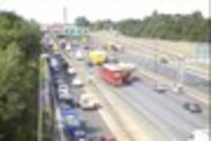 live updates as motorists face six miles of queues on the...