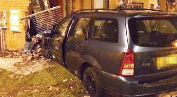 car crashes into belfast home - residents 'narrowly escape injury'