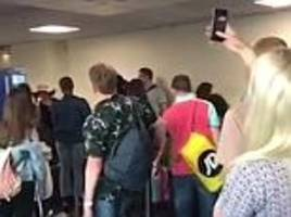 EasyJet passengers confront staff at Luton airport