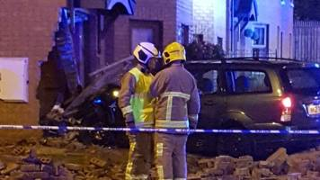 car crashes into west belfast home