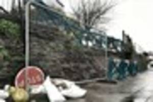 Collapsed wall is finally being repaired along one of Plymouth's...