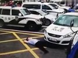 con man pretends he's been hit by a police car