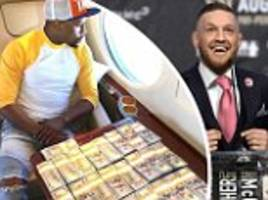 floyd mayweather flashes the cash on his private jet