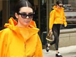 kendall jenner sports bright yellow jacket at an nyc gym