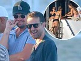 Leonardo DiCaprio surrounded by women  on St Tropez yacht