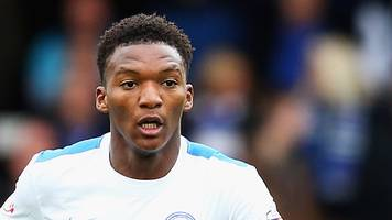 kgosi ntlhe: rochdale sign defender on a free transfer from stevenage