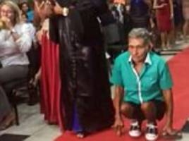 disabled dad walks with daughter at graduation in brazil