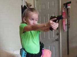 texas girl practices her speed and skill loading handgun