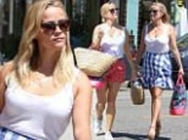 Reese Witherspoon shows off toned legs in summery outfits