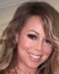 Mariah Carey parades colossal cleavage in dress slashed past privates