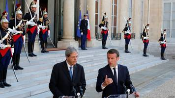 an angry, irritated italy loses patience with macron over migrants, libya
