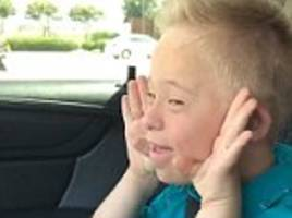 texas boy with down's syndrome belts whitney houston song