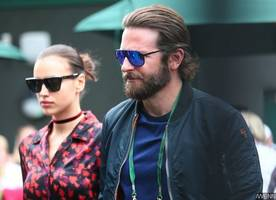 see bradley cooper and irina shayk's daughter as he holds her in a carrier