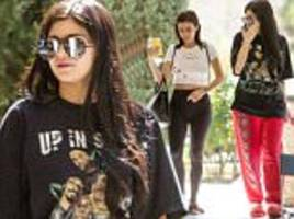 kylie jenner sports a t-shirt and sweats as she grabs food