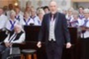Watch 92-year-old reunited with beloved choir in his care home