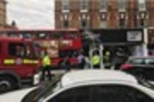Croydon firefighters help rescue two trapped passengers on bus...
