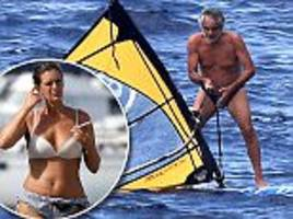 andrea bocelli, 58, windsurfs on vacation with his family