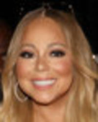 braless mariah carey's cleavage explodes from plunging dress — but fans are unimpressed