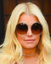 jessica simpson's extremely plunging dress is no match for colossal cleavage
