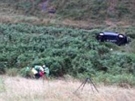 escape for woman after her car plunged into a ravine