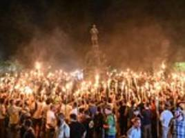white nationalists hold torch-lit march through uva campus