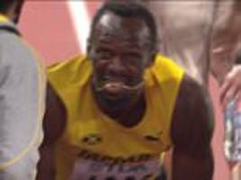 Bolt pulls up injured in relay as Great Britain wins