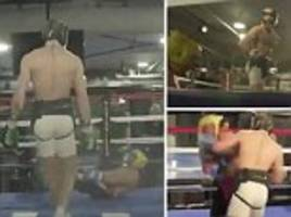 conor mcgregor knocks down paulie malignaggi in video