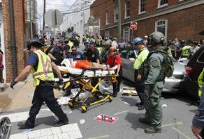 Charlottesville clash between white nationalists and counter-protesters gets out of hand as vehicle hits crowd ...