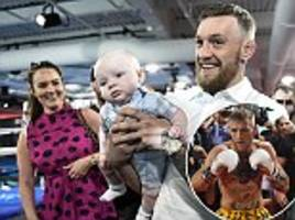Conor McGregor shows off baby son after training session