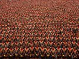 Indonesian men do traditional dance in tourism drive
