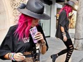Pink-haired Bella Thorne channels her inner rock chick