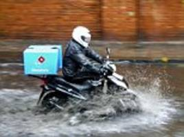 domino's driver ploughs scooter through flood in london