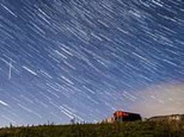 sky lights up at night as perseid meteors visit earth