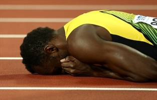 Usain Bolt's illustrious career ends in tears after cramp downs him in final race