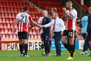 too many games in opening month, says cheltenham town manager gary johnson